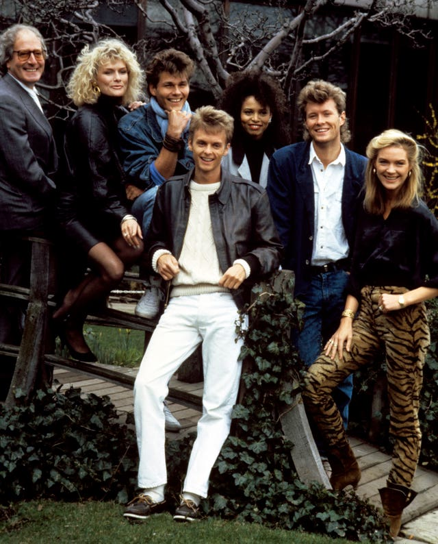 A-ha pictured in 1987 with composer John Barry (far left) to promote the title song for the James Bond film The Living Daylights