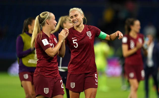 Beth Mead celebrates England's win with captain Steph Houghton