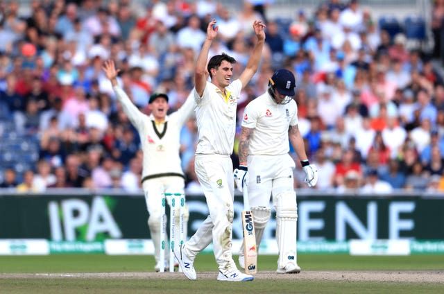 Pat Cummins, centre, celebrates the wicket of Ben Stokes