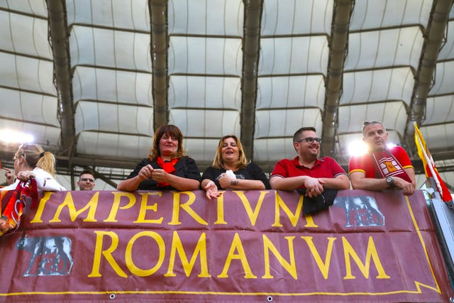 AS Roma fans hang banners in the stands (Steven Paston/PA)