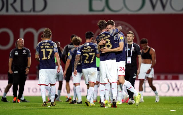 Barnsley celebrate survival after their win at Brentford