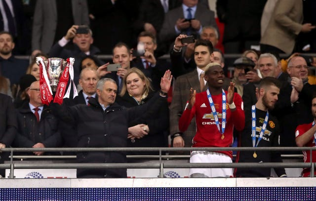 Jose Mourinho with the trophy after Manchester United beat Southampton