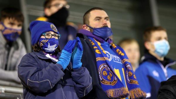 Fans relish return to football stadiums