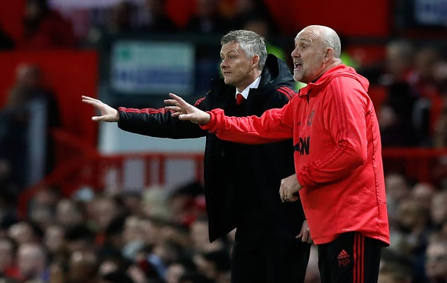 Ole Gunnar Solskjaer, left, and assistant Mike Phelan will remain at Old Trafford (Martin Rickett/PA)