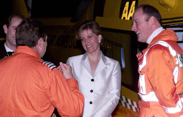 The Earl (partially concealed left) and Countess of Wessex at a TVAA fundraising dinner with helicopter pilot Andy Busby (left) and paramedic Tim Goddard, part of the air ambulance crew who airlifted Sophie to hospital. Andrew Stuart/PA Wire