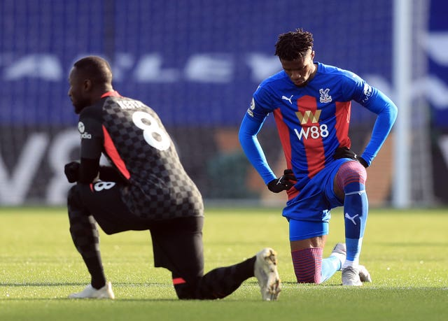 Crystal Palace's Wilfried Zaha, right, says he will stop taking the knee before matches