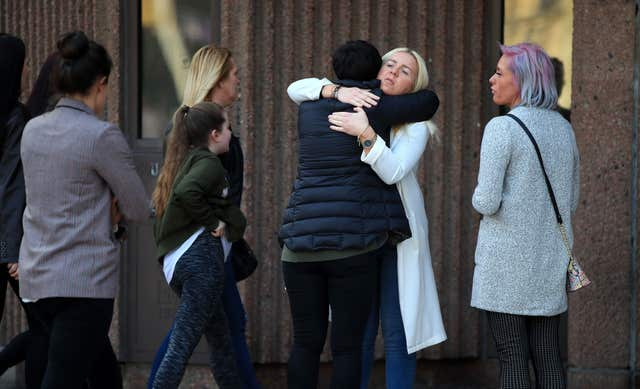 The murdered woman's sister Nadine Hayes is comforted as she arrives at Liverpool Crown Court (Peter Byrne/PA)