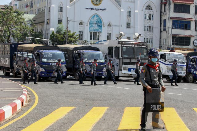 Riot policeman stand guarding outside Yangon City Hall (AP)