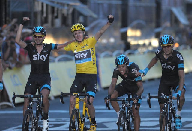 Froome celebrates with Team Sky teammates as he crossed the line to win his first Tour de France in 2013