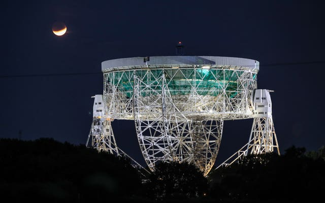 The partial lunar eclipse was visible above the Jodrell Bank Observatory in Cheshire