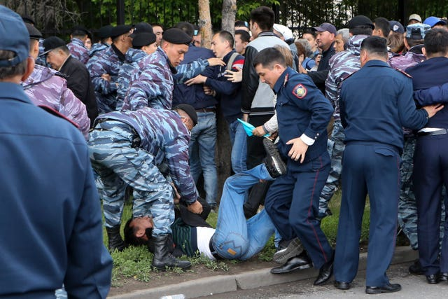 Kazakh police detain a demonstrator
