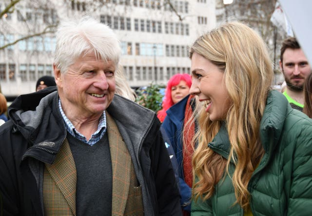 Carrie Symonds, partner of Prime Minister Boris Johnson, and his father Stanley Johnson (John Stillwell/PA)