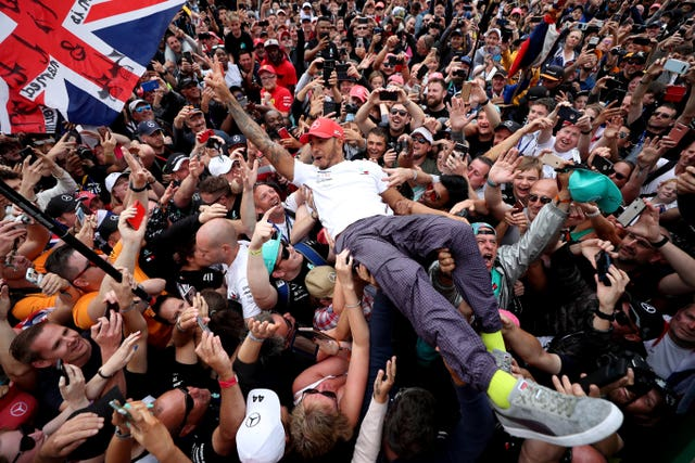 Lewis Hamilton celebrates putting his name alongside Formula One's immortals after driving to a record sixth British Grand Prix victory. Hamilton lapped up the adulation of the 141,000 fans at Silverstone having surpassed Jim Clark and Alain Prost as the king of the British race