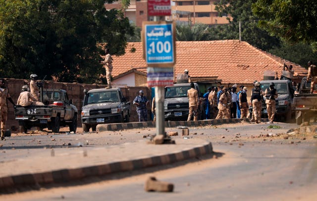 Security forces prevent demonstrators from reaching the Sudanese army headquarters (Marwan Ali/AP)