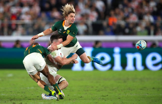 Tom Curry is flattened by South Africa's Faf de Klerk in the final