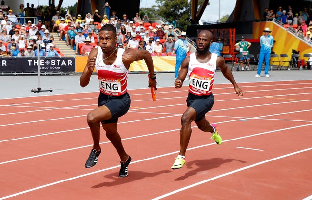 England's Zharnel Hughes (left) and Reuben Arthur (right) compete in a men's 4 x 100m relay heat at the Carrara Stadium