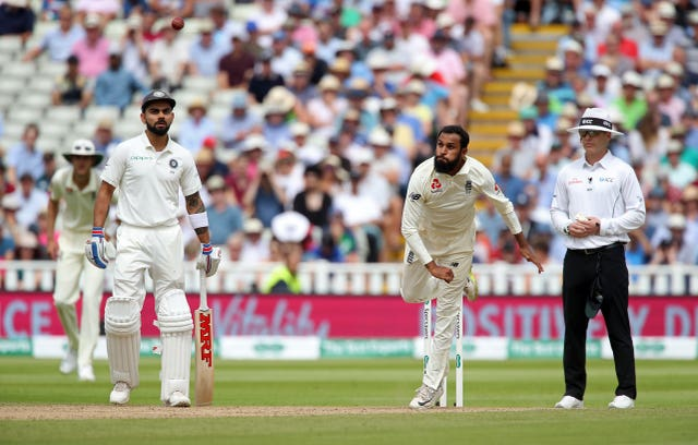 Adil Rashid, centre, in Test action against India in 2018