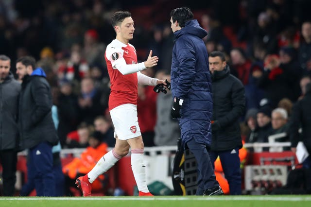 Mesut Ozil, left, has struggled to establish himself under Unai Emery