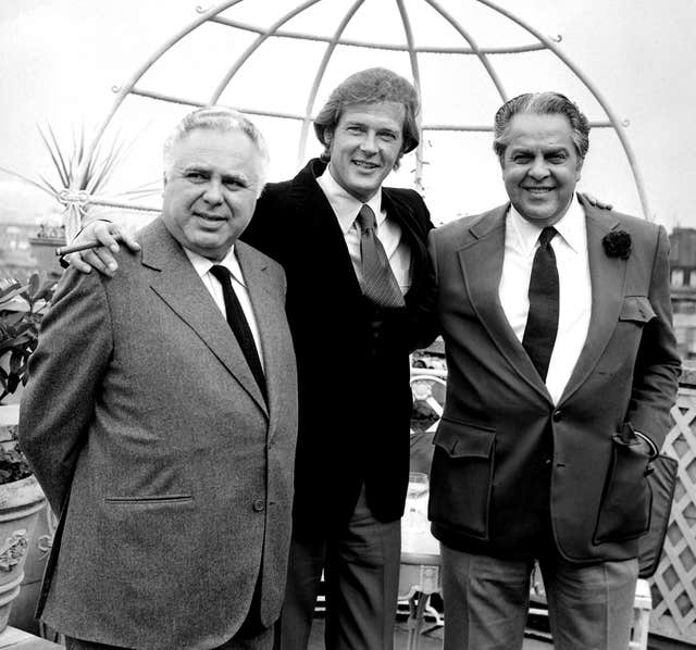 Roger Moore with producers Albert R Broccoli (right) and Harry Saltzman (left)