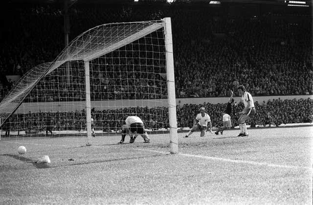 Kenny Dalglish, second right, turns away after scoring Scotland's winner at Hampden Park