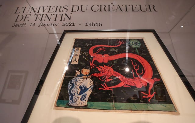 The inked and water-painted original panel of the comic character Tintin from the 1936 The Blue Lotus album drawn by Belgian creator Herge, is displayed at the Artcurial auction house in Paris (Michel Euler/AP)