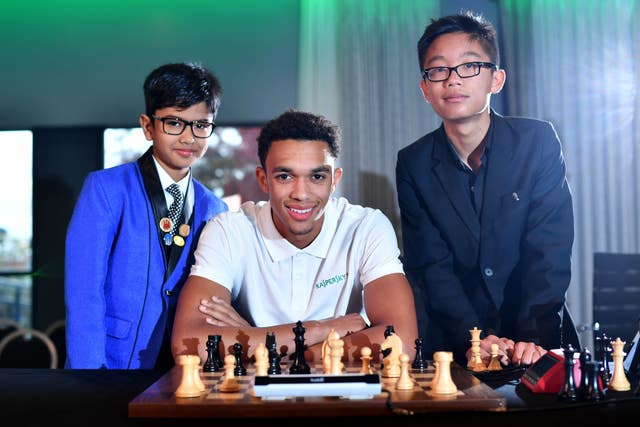 Alexander Arnold with his advisers Shreyas Royal (left) and Kyan Bui