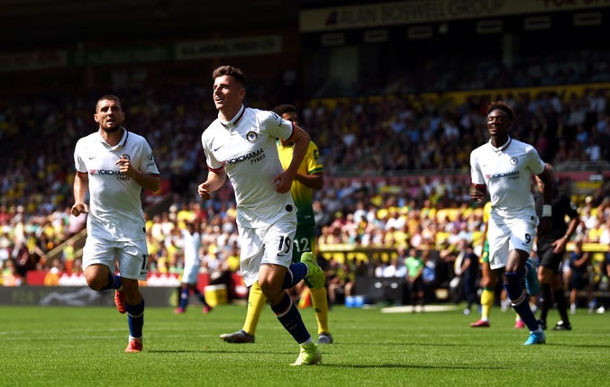 Mason Mount, centre, celebrates his goal at Carrow Road