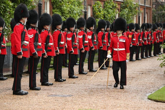A Guard of Honour of the Coldstream Guards for French president Emmanuel Macron upon his arrival at Clarence House in London
