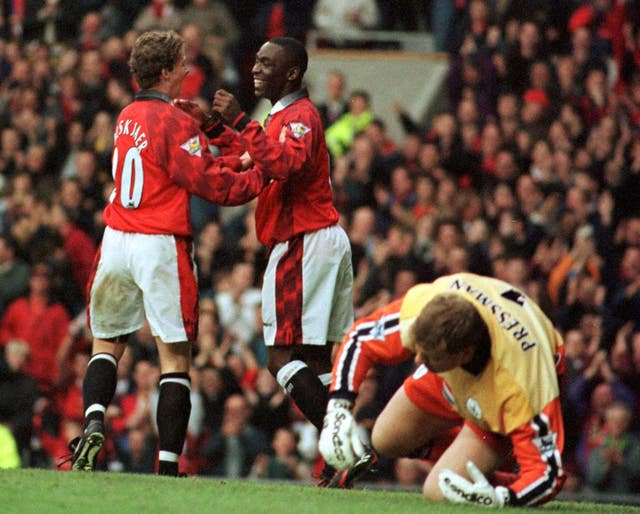 Andy Cole and Ole Gunnar Solskjaer celebrate scoring at Old Trafford