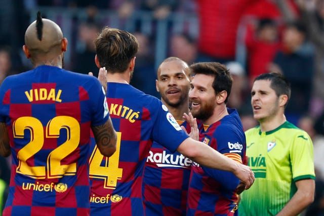 Messi is mobbed by his team-mates at the Nou Camp