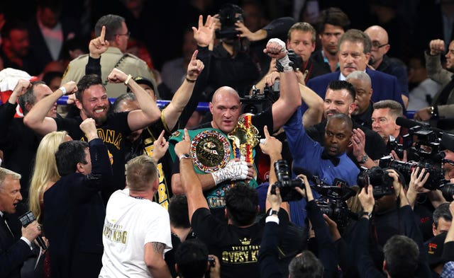 Tyson Fury (centre) got his hands on the belt