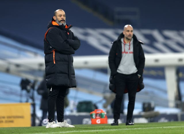 Pep Guardiola (right) feels City could learn much from their game against Wolves