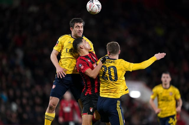 Arsenal's Sokratis (left) and Shkodran Mustafi battle for the ball with Bournemouth's Dominic Solanke during the FA Cup fourth round