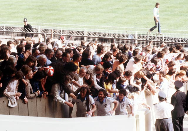 West Ham are congratulated by fans as they climb the steps to receive the FA Cup