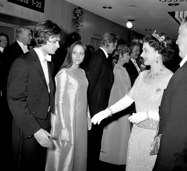 Queen Elizabeth II talking with Olivia Hussey and Leonard Whiting
