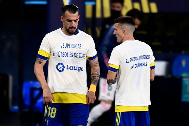 Cadiz's Alvaro Negredo (left) and Salvi Sanchez wear T-shirts in protest against the European Super League ahead of their match against Real Madrid