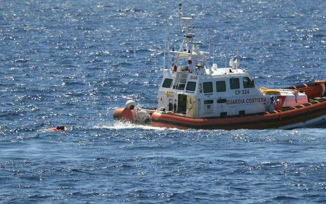 A migrant is rescued by the Italian coastguard