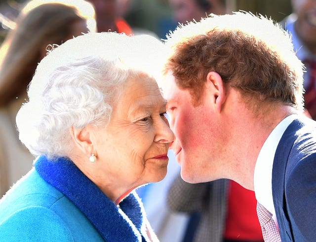 Queen Elizabeth II greets her grandson Prince Harry at the annual Chelsea Flower Show (Julian Simmonds/The Daily Telegraph/PA)