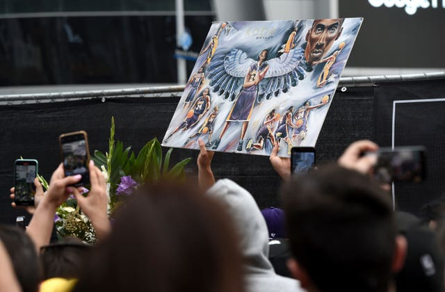 Fans took photos of artwork featuring the former Los Angeles Laker