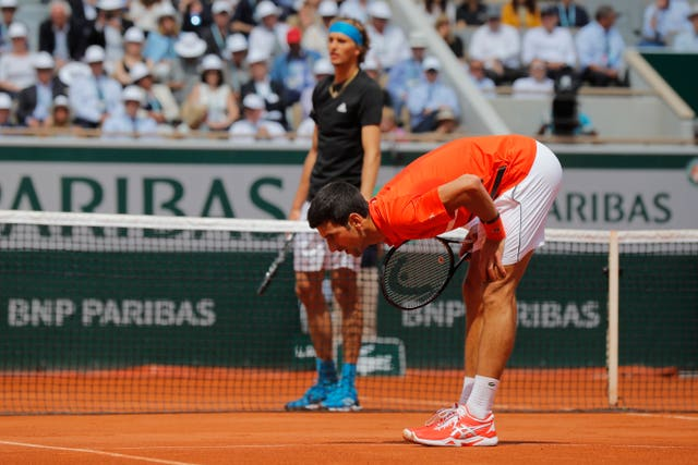 Novak Djokovic checks the ball mark on the clay court