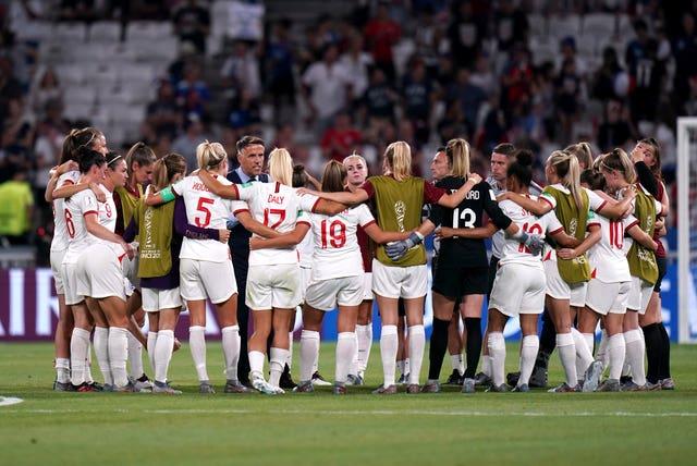 England players form a huddle around head coach Neville