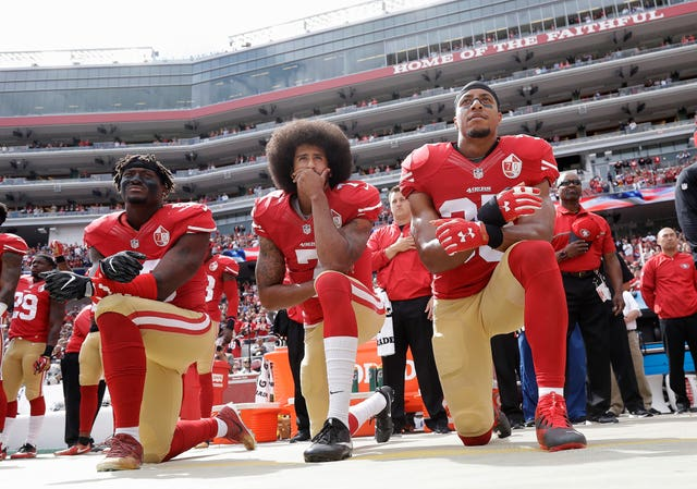 San Francisco 49ers outside linebacker Eli Harold, quarterback Colin Kaepernick and safety Eric Reid kneel during the national anthem before an NFL game in 2016