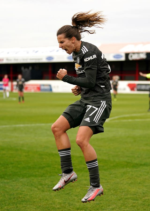 Tobin Heath celebrates her first Manchester United goal
