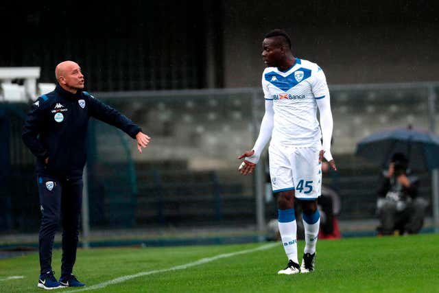 Brescia's head coach Eugenio Corini, left, offered Balotelli support (Simone Venezia/ANSA via AP)