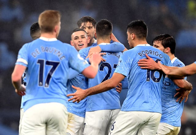Manchester City players gather to celebrate Phil Foden's goal against Brighton on Wednesday evening