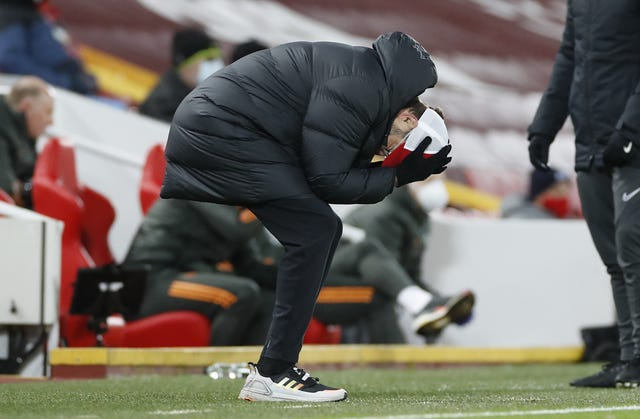 Liverpool manager Jurgen Klopp holds his head in his hands