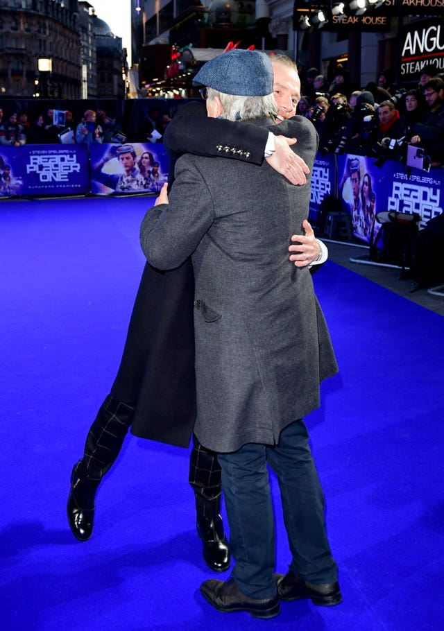 Pegg and Spielberg share an opportune hug