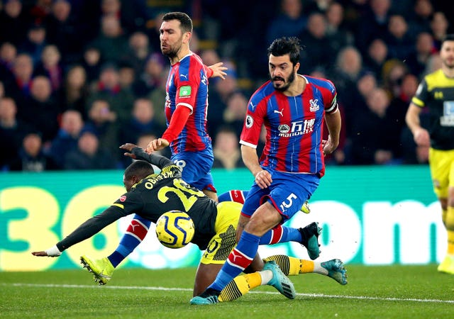 Crystal Palace defender James Tomkins, right, will be absent against Bournemouth