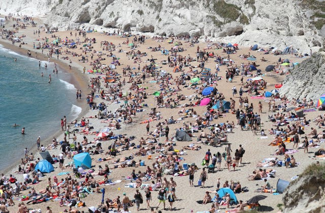 People on the beach at Durdle Door on Sunday (Andrew Matthews/PA)