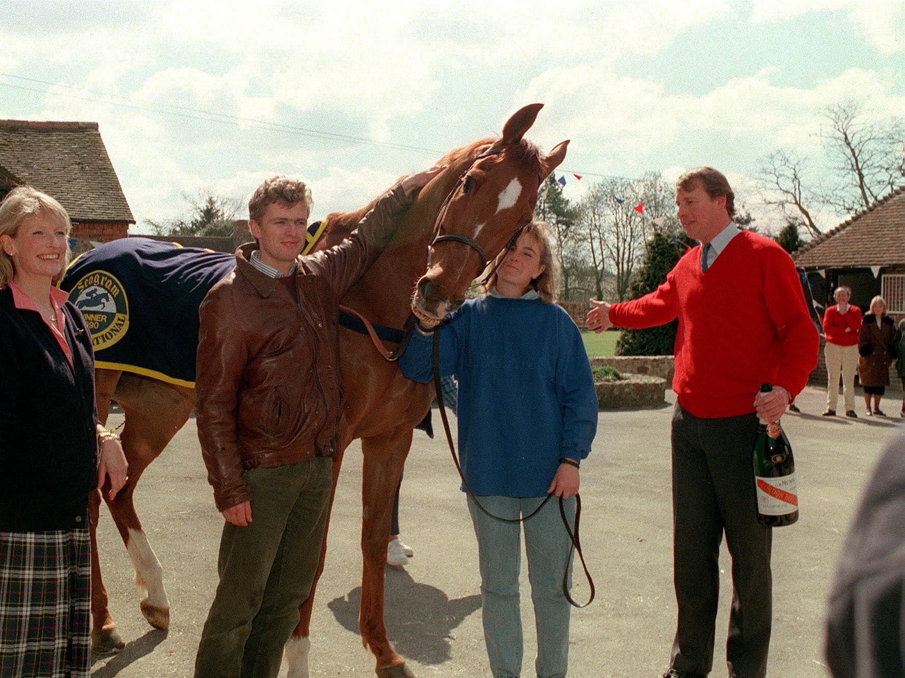 Kim Bailey (right), with wife Tracey (left), jockey Marcus Armytage and Mr Frisk after his 1990 Grand National win (David Giles/PA)